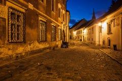 Bratislava Old Town Street at Night. City of Bratislava in Slovakia, Old Town, cobblestone Kapitulska street by night Royalty Free Stock Images