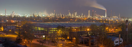 Bratislava - The panorama of oil refinery Slovnaft in Slovakia in evening dusk. Royalty Free Stock Photos