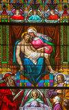 Bratislava - Pieta on windowpane from 19. from manufactures of Karola Geyling and Eduarda Kratzmann in st. Martin cathedral. Stock Photography