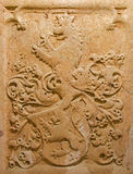 Bratislava - Relief of symbolic lion. Detail from tomb stone in crypt under st. Ann chapel in st. Martin cathedral. Stock Photos