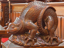 Bratislava - Reptile symbolic carved sculpture from bench in presbytery in st. Matins cathedral. BRATISLAVA, SLOVAKIA - FEBRUARY 11, 2014: Reptile symbolic Royalty Free Stock Photos