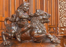 Bratislava - Rider on the lion sculpture from bench in presbytery in st. Matins cathedral Stock Image