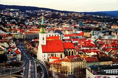 Aerial view of historical buildings in Bratislava, Slovak Republic. Bratislava, Slovakia. Aerial view of illuminated historical buildings with car traffic in the Stock Photography