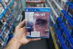 An holding Detroit videogame on Sony Playstation 4. Bratislava, Slovakia, circa may 2018: Man holding Detroit videogame on Sony Playstation 4 console in store Royalty Free Stock Photography