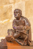 BRATISLAVA, SLOVAKIA - FEBRUARY 11, 2014: The man at prayer sculpture from bench in presbytery in st. Matins cathedral Stock Photos