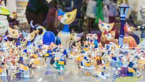 BRATISLAVA, SLOVAKIA - JANUARY 4, 2014: moon-faced cat figurines. By Rosina Vahtmayster on the counter gift shop Stock Images