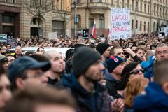 More than 60 thousand people hold an anti-government rally in Bratislava, Slovakia on March 16, 2018. BRATISLAVA, SLOVAKIA - MAR 16, 2018: Protesters hold signs Stock Photos