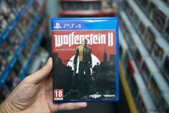 Man holding Wolfenstein 2: The New Colossus videogame Stock Photography
