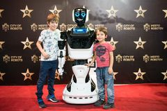 Portrait of Robot MATTHEW with two young boys