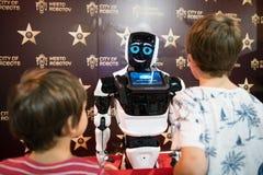 Two boys look at robot MATTHEW