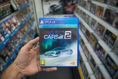 Man holding Project Cars 2 videogame on Sony Playstation 4 console in store. Bratislava, Slovakia, october 2 2017: Man holding Project Cars 2 videogame on Sony Stock Image