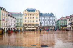 BRATISLAVA, SLOVAKIA - OCTOBER 16, 2015: Tourists in Main Square Stock Photography