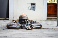 Bratislava statue. Cumil, the happy sewage worker statue on August 9, 2012 in Bratislava, Slovakia. It was created in 1997 by artist Viktor Hulik and is one of stock images