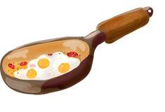 Bratpfanne mit durcheinandergemischten Eiern Lizenzfreies Stockfoto