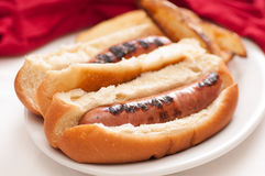 Brats on buns Royalty Free Stock Image