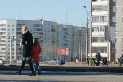 Bratsk,street Krupskoy-Ryabikova. Bratsk street in the semple day with house Stock Photography