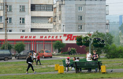 Bratsk street Krupskoy 27. Bratsk street in the semple day with peoples Stock Photo