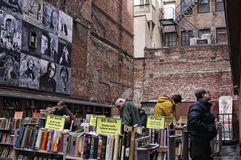 Brattle Book 1. Outdoor bookstore with male shoppers in New England winter. 2-25-13 Brattle Book Shop-- 9 West St. Boston, Massachusetts-- The store has a unique Royalty Free Stock Photo