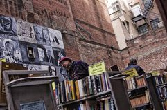 Brattle Book 2. Outdoor bookstore with man in barrette shoppers during New England winter. 2-25-13 Brattle Book Shop-- 9 West St. Boston, Massachusetts-- The Stock Images