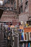 Brattle Book 5. Outdoor bookstore with two men and a woman shopping during New England winter. 2-25-13 Brattle Book Shop-- 9 West St. Boston, Massachusetts-- The Stock Image