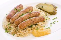 Bratwurst com Sauerkraut imagem de stock royalty free