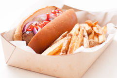 Bratwurst and crispy fries Royalty Free Stock Images