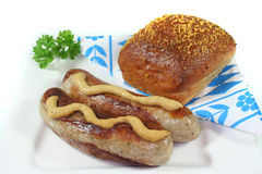 Bratwurst with mustard and bread Royalty Free Stock Photos