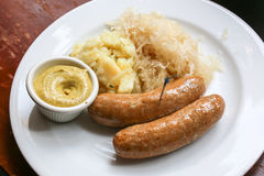 Bratwurst on plate Stock Image