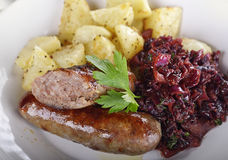 Bratwurst with Red Cabbage and Potatoes Royalty Free Stock Image