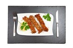 Bratwurst - salchicha frita - visión superior Fotografía de archivo libre de regalías