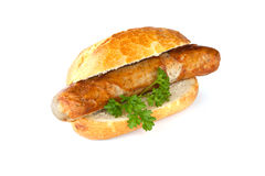 Bratwurst - Sausage, bread and parsley Royalty Free Stock Image
