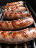 Bratwurst sausages on grill Royalty Free Stock Photo