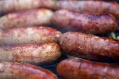 Bratwurst sausages on grill. Close-up Royalty Free Stock Photography