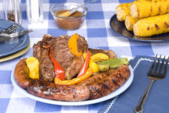 Bratwurst and steak picnic dinner Stock Photography