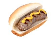Bratwurst sur un pain image stock