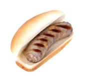 Bratwurst sur un pain photographie stock