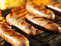Bratwursts on grill with corn Royalty Free Stock Images