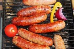Bratwursts sur un gril Images libres de droits