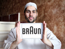 Braun logo. Logo of electronics and kitchen appliance company braun on samsung tablet holded by arab muslim man Royalty Free Stock Photo