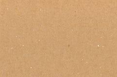 Braune Beschaffenheit des Packpapiers Papp, natürlicher rauer strukturierter Kopienraumhintergrund, helle Sonnenbräune, Gelb, bei Lizenzfreie Stockbilder