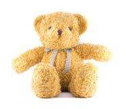 Braune Farbe des TEDDYBÄREN mit Band auf weißem Hintergrund Lizenzfreies Stockbild