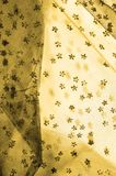 braune Spitze auf dem weißen Hintergrund, der die Neuheit von Spitze m vorstellt stockfotografie