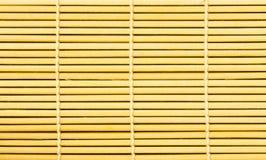 Braune Strohbambusmatte als abstrakter Beschaffenheitshintergrund Lizenzfreies Stockbild