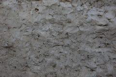 Braune Wand des Lehms des alten Hauses Strukturierter Hintergrund Lizenzfreies Stockbild