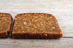 Braunes Brot des vollständigen Kornes Lizenzfreie Stockbilder