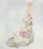 Braut in einem Blumenkleid Stockfotos