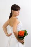 Braut in einem Hochzeitskleid Stockfoto