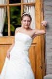 Braut in einem Hochzeitskleid Stockbild
