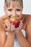 Braut mit Apfel Stockfotografie