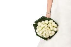 Braut mit Blumenstrauß der Rosen Stockbild